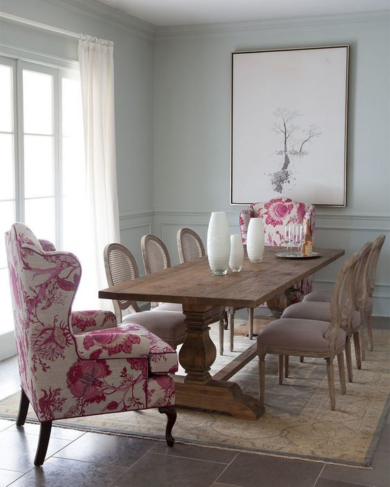 pop of color pink chairs in neutral dining room