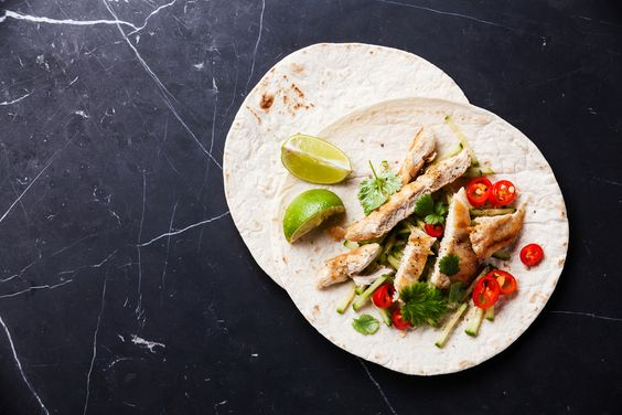 A big sizzling platter of fajitas is always a crowd pleaser. A quick marinade adds tons of flavor to chicken breasts that are then grilled and sliced. A variety of toppings lets everyone personalize