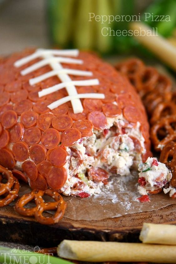 This Pepperoni Pizza Football Cheese Ball is easy to make and a total showstopper! Make this for your next game day celebration and watch the crowd go wild!: