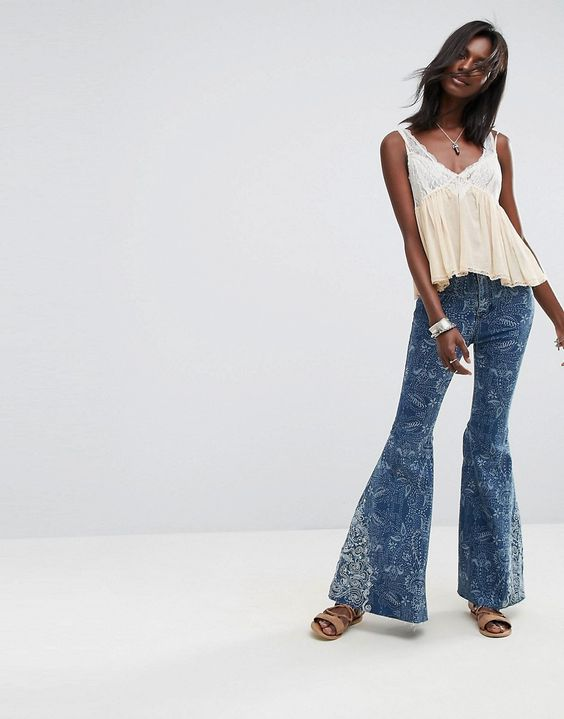 Get this Free People's bell-shaped jeans now! Click for more details. Worldwide shipping. Free People Embellished Float On Flared Jeans - Blue: Flare jeans by Free People, Stretch denim, Embellished detailing, Mid blue wash, Concealed fly, Functional pockets, Flared fit - cut with a straight leg that flares at the ankle, Machine wash, 53% Cotton, 23% Rayon, 22% Polyester, 2% Spandex, Our model wears a W26� and is 176cm/5'9.5 tall. With roots back to the �70s, the Free People girl lives th...