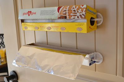 Mounting foil and wrap inside cabinet door using plastic hooks. Why didn't I think of this?!