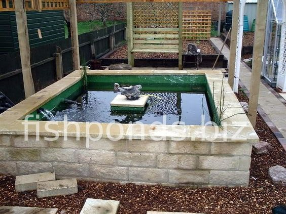 Above ground pond designs building a koi pond finished for Above ground fish pond ideas