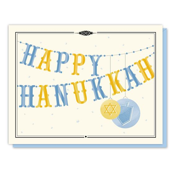 """Blank inside A festive garland with hand-applied glitter* beads spells out """"Happy Hanukkah."""" Printed on cream, FSC certified, post-consumer recycled content paper. It comes individually packaged in a:"""