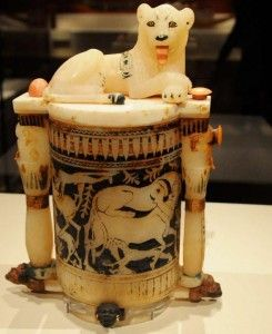 Cosmetic jar with Lion. This magnificent jar is carved of calcite and has details of gold, paint and colored ivory, depicting images of fighting animals. The faces at the foot of the jar represent the traditional enemies of Egypt. The two columns on the side contain an image of the God Bes.