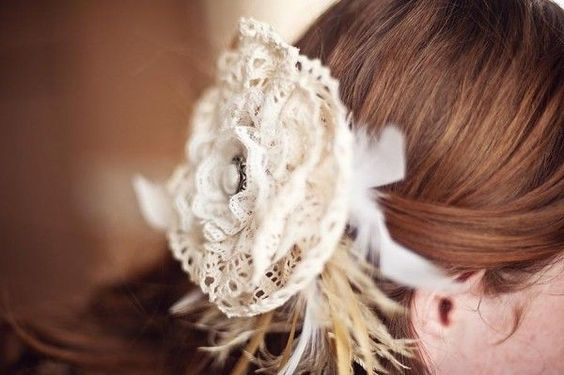 Lace and feather hair accessory.