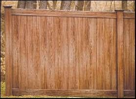 Grand Illusions Color and Woodgrain Vinyl Fence Featured in the World Fence News