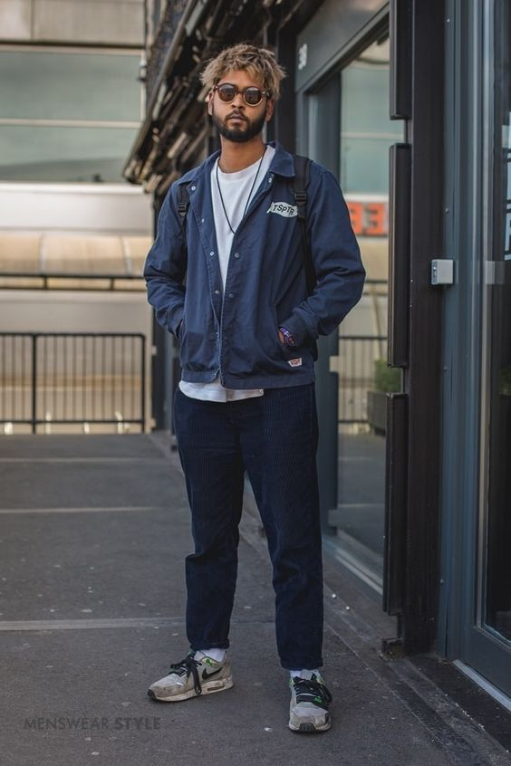 This is Shakeel on the streets of London in 2020 wearing Nike Trainers, Navy Work Jacket, Navy Cord Trousers, and Grey T-Shirt.