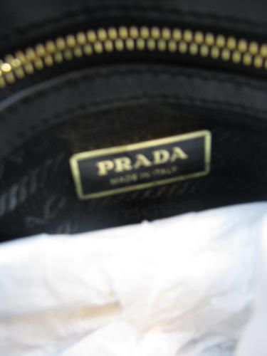 spot a fake prada purse