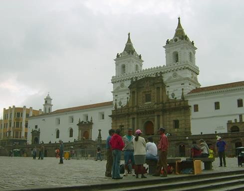 White church people with people in front in Quito
