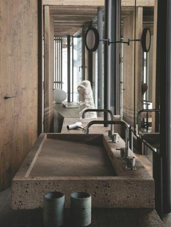 vasque en pierre dans une villa contemporaine                                                                                                                                                     Plus