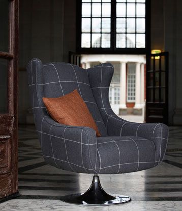 Cool manly swivel chair in cut in a very savile row fabric