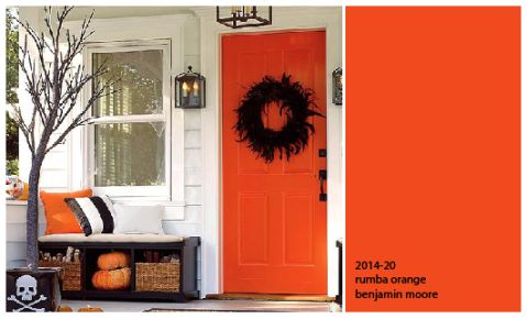 White siding and trim with an orange front door
