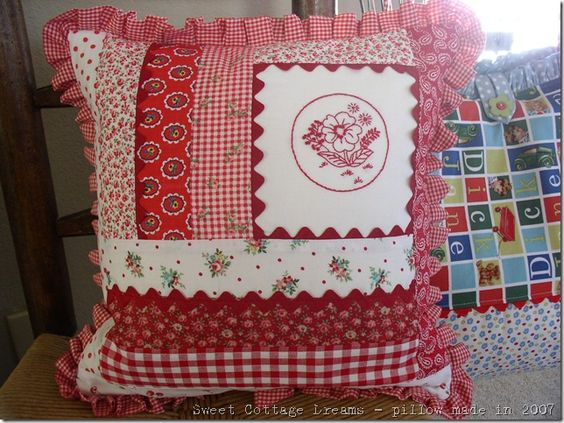 Sweet pillow by sweetcottagedreams~Redwork she stitched & added florals,checks, ric rac & ruffles!....LUV!