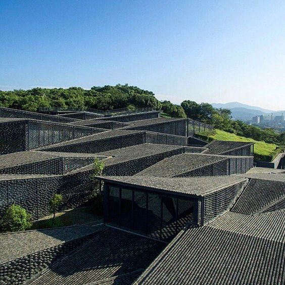 kengo kuma's latest museum project china academy of art opens in hangzhou. blending with the topography the buildings are topped with discarded roof tiles. #architecture  read more about the #kengokuma scheme online at #designboom.com by designboom