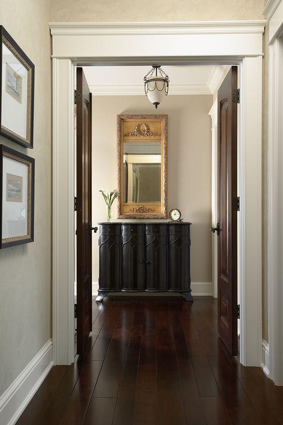 Entryway: dark floors, light walls.