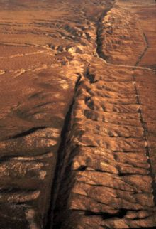 The San Andreas Fault in California is over 800 miles long!  Movement along this rock produces many earthquakes.  Can you see where the rock  has shifted?