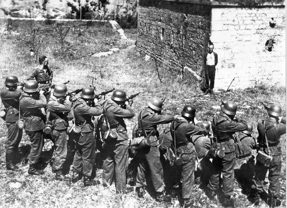 French Resistance member Georges Blind smiling in front of a German execution squad. October 1944