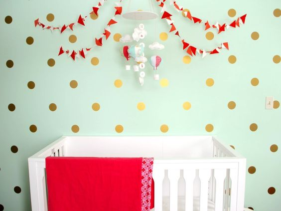 Mint Nursery with Coral and Gold Accents - we can't get enough of the gold polka dot accent wall!