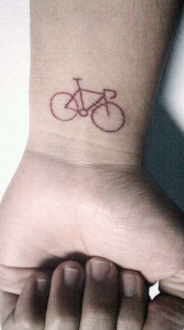 A simple one-line tattoo. Riding a bike has helped me reach important decisions in life. It clears my head. It's my favourite companion on a journey.