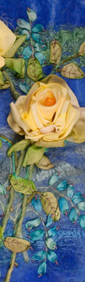 Beautiful ribbon embroidery. I might have to get this kit! Roses on blue