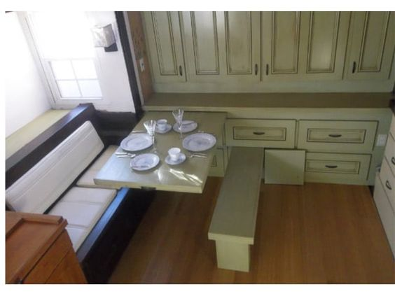 Pull out table and bench. Cabinets are also pull out and this wall unit is under a loft.
