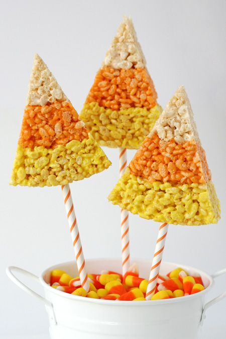 good idea: Candy Corn Krispie Treats. You could use Popsicle sticks, I'm not sure if paper straws are strong enough