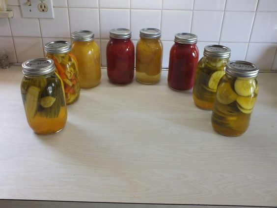 Weekend project: Four quarts of red tomatoes and lemon boy tomatoes and four quarts of garlic, banana peppers carrots, green bell peppers, and cucumbers canned.