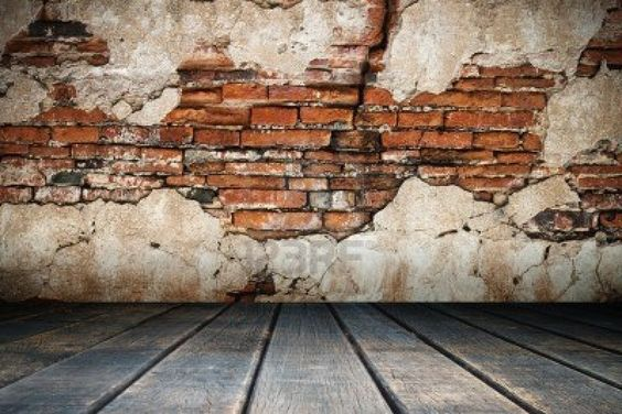 Cracked plaster of old brick wall and wood floor stock for Distressed brick wall mural