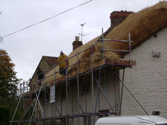 A cottage being re thatched. Photo by Tori Leslie