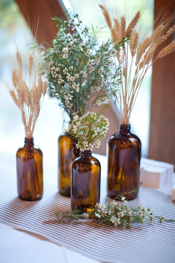 ??? Momma has the hookup on these type of bottles. Bunched together, different sizes, tied with a ribbon/lace???: Beer Bottle Centerpiece, Medicine Bottle, Wedding Ideas, Wheat Centerpiece, Glass Bottles, Amber Bottles