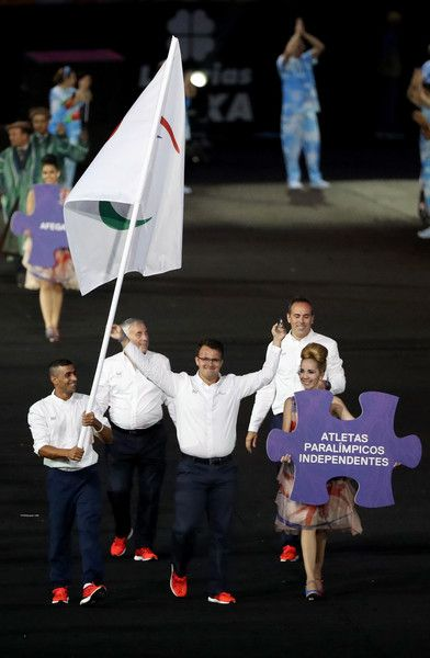Flag bearer Ibrahim Al Hussain of Syria leads the Independent Paralympic Athletes team entering the stadium during the Opening Ceremony of the Rio 2016 Paralympic Games at Maracana Stadium on September 7, 2016 in Rio de Janeiro, Brazil.