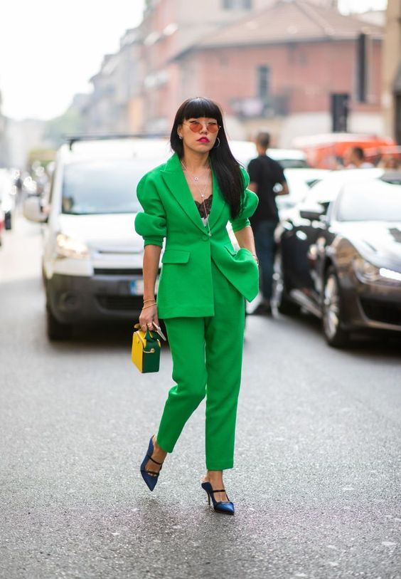 MILAN, ITALY - SEPTEMBER 19: A guest wearing green suit is seen outside Jil Sander during Milan Fashion Week Spring/Summer 2019 on September 19, 2018 in Milan, Italy. (Photo by Christian Vierig/Getty Images)