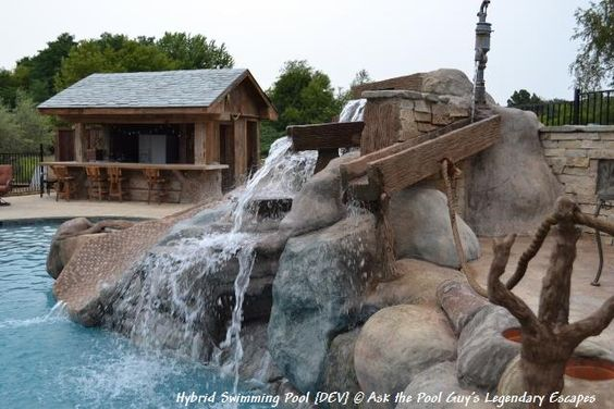 This waterfall and waterslide is completely customized for this pool as well as everything was hand carved and created out of cement, this was a custom design. Hybrid Pool Saline Michigan DEV (12)