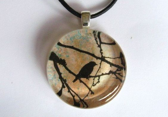 Crow, Blackbird, Bare Tree - Glass Pendant with Leather Cord, via Etsy.
