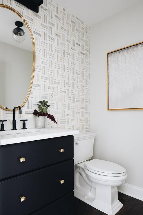 Marble And Brass Tiles Create A Stunning Bathroom Accent Wall Featuring A Gold Mirror Above A Black Wash Bathroom Accent Wall Bathroom Accents Powder Room Tile