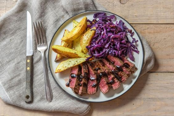 Hearty steak and potatoes with balsamic cranberry pan sauce: