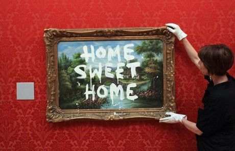 "Bansky's graffiti art ""Home Sweet Home"""
