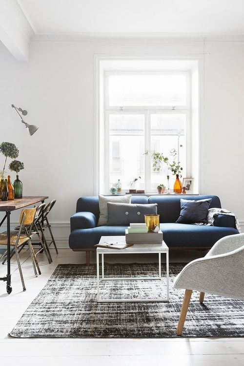 Semi- masculine interior design; white, navy blue, grey; modern, clean, bright; living room: