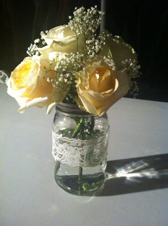 Antique roses in a mason jar with lace