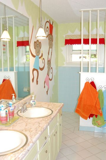 Adorable kiddy bathroom with privacy to potty and have some independence if mom needs to follow behind to keep an eye out for needed assistance when the baby is new to the potty.: