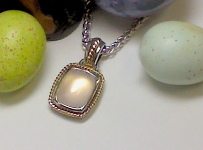 Rose quartz in sterling silver with gold accents.