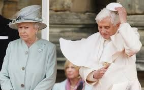 QUEEN LOOKS PISSED OFF AT POPE HERE.. MAYBE HE ORDERED HER TO DO SOMETHING SHE DOESN'T WANT TO OR JUST DID A FART?