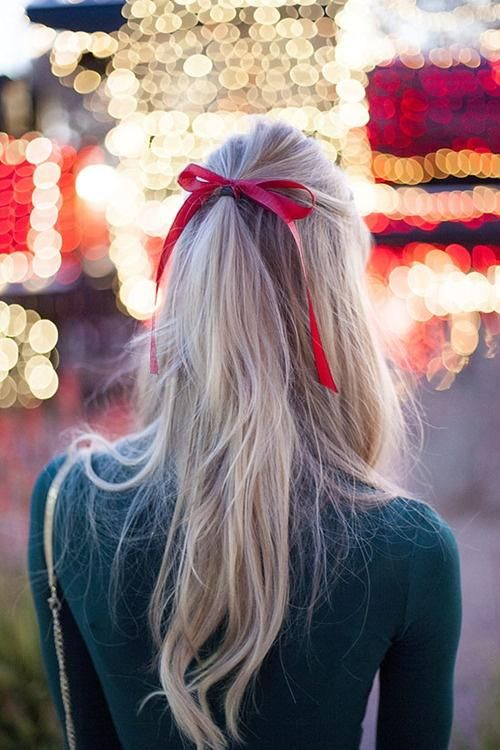 red bow ribbon in half up hair: