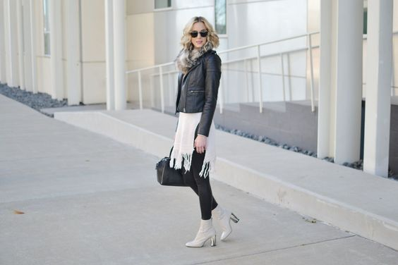 fringe hem tunic sweater, leather jacket, faux fur scarf, leather leggings, cream boot by @straightastyle