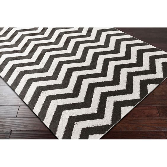 Bring luxury to your home with this modern designed area rug. Crafted from polypropylene and versatile colors, this rug is sure to be the perfect addition to any decor. Primary materials: 100-percent