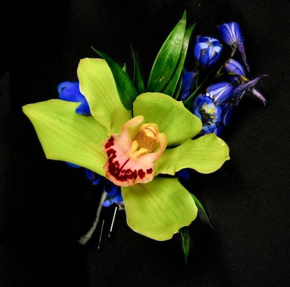 Exotic. bright green cymbidium orchid with deep blue delphinium accents. #limegreenwedding #greenwedding #orchidwedding #greenorchid #orchidboutonniere #greenbluewedding #tropicalweddding