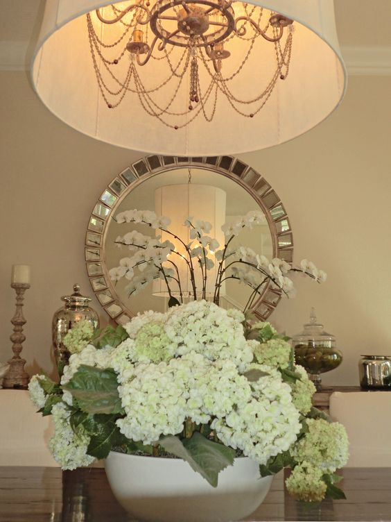 Dining room centerpiece round mirrors and living