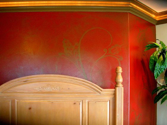 really liking this red wall with gold glaze finish...