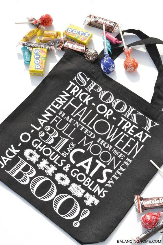 A plain black tote bag can be completely transformed into this stunning Halloween trick or treat bag using these free printables!