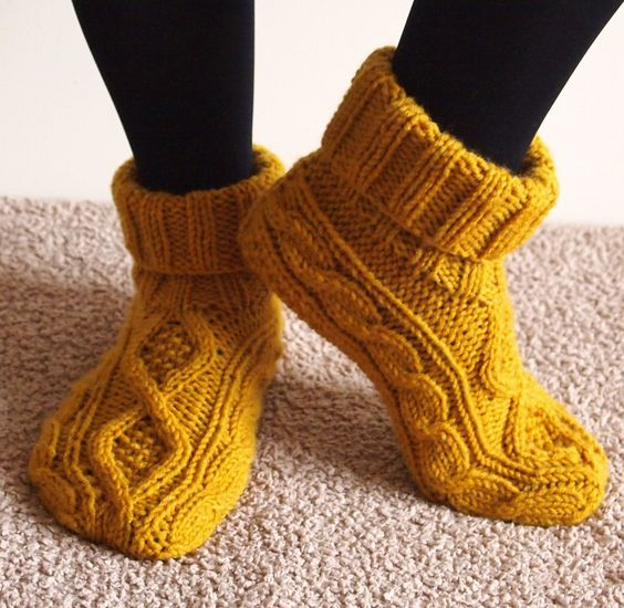 Free Knitting Pattern for Celtic Dancer Slippers - DROPS Design created these cuffed slippers with two cable patterns. Pictured project by Carmela-Biscuit